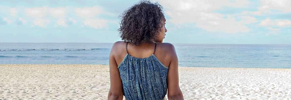 Woman Looking out onto Beach